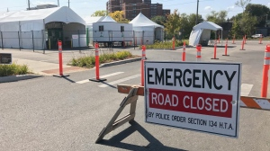 An emergency road closure sign seen at the drive-thru COVID-19 testing clinic in Kitchener, Ont., on Sept. 23, 2020. (Dan Lauckner / CTV Kitchener)