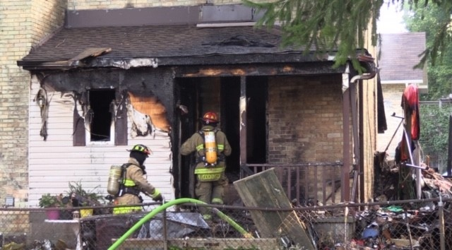 Firefighters work at the scene of an apartment fire in a home in Wingham, Ont. on Wednesday, Sept. 23, 2020. (Scott Miller / CTV News)