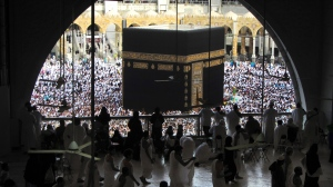 In this May 25, 2019 file photo, Muslim worshippers circumambulate the Kaaba, the cubic building at the Grand Mosque, during the minor pilgrimage, known as Umrah in the Muslim holy city of Mecca, Saudi Arabia. Authorities on Monday, Sept. 21, 2020, released new details on how it plans to gradually allow Muslims back to Islam's holiest site in Mecca to perform the smaller-year-round pilgrimage, which has been suspended for the past seven months due to the coronavirus (AP Photo/Amr Nabil, File)