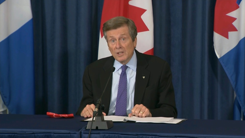 Mayor John Tory speaks with reporters during a briefing at city hall on Sept. 23.