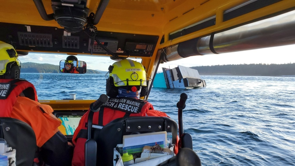 A houseboat sinks off B.C.'s Galiano Island on Sunday, Sept. 20, 2020. (Royal Canadian Marine Search and Rescue)