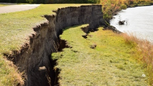 A piece of earth has broken away from the riverbank along the Rotary Trail in Prince Albert.