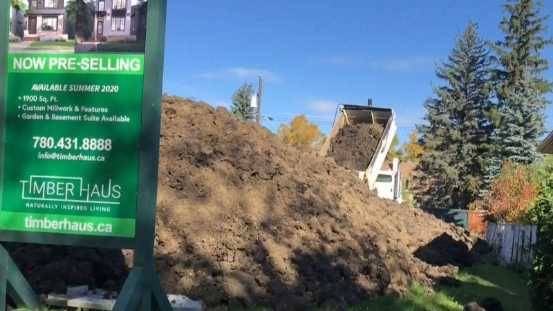Neighbours fed up with builder over dirt pile