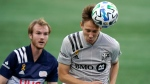 Montreal Impact's Lassi Lappalainen, right, heads the ball as New England Revolution's Henry Kessler, left, pursues during the first half of an MLS soccer match, Wednesday, Sept. 23, 2020, in Foxborough, Mass. (AP Photo/Steven Senne)