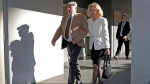 Don Spiers, left, and Carol Spiers, center, the parents of Sarah Spiers, arrive at the Supreme Court of Western Australia in Perth, Thursday, Sept. 24, 2020. (Richard Wainwright/AAP Image via AP)