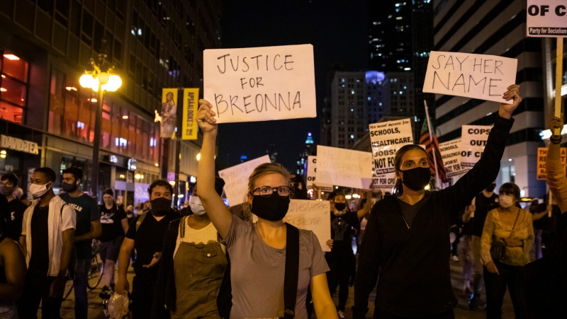 Protesters over the decision by a grand jury not to indict police officers for the fatal shooting of Breonna Taylor in Kentucky march down Michigan Avenue near Millennium Park in Chicago on Wednesday night, Sept. 23, 2020. (Ashlee Rezin Garcia/Chicago Sun-Times via AP)