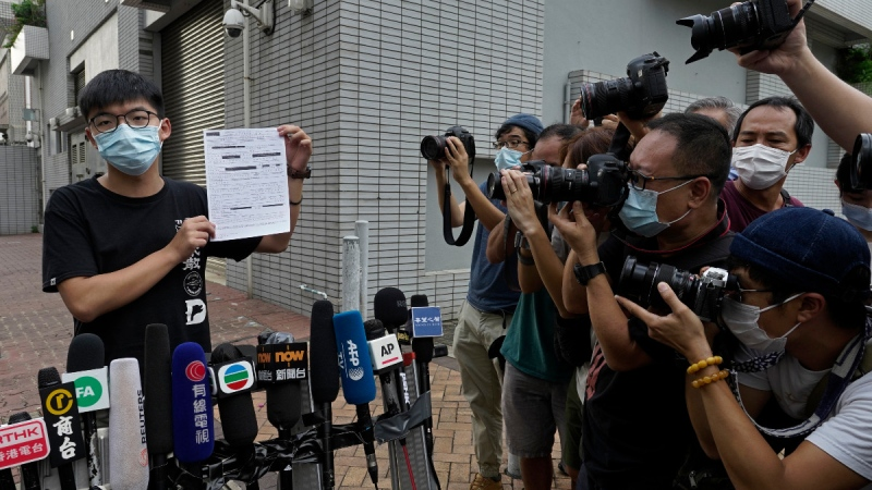 Hong Kong pro-democracy activist Joshua Wong displays a bail paper outside the Central Police Station in Hong Kong, on Sept. 24, 2020. (Vincent Yu / AP)