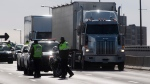Quebec provincial police will be on the highway Thursday in a major operation to curb speeding, using phones while driving and being impaired behind the wheel. THE CANADIAN PRESS/Adrian Wyld