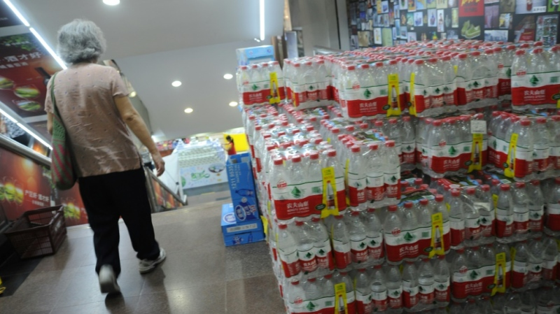 Nongfu Spring, with its distinctive labelling, is reported to be China's biggest producer of bottled water, a feat that has propelled founder Zhong Shanshan to the top of the country's rich list. (AFP)