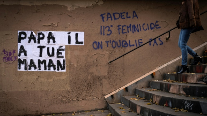 'Dad killed my mom,' part of a Paris graffiti campaign to highlight domestic violence. (AFP)