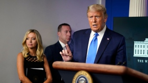 President Donald Trump speaks during a news conference in the James Brady Press Briefing Room of the White House Wednesday, Sept. 23, 2020, in Washington, as White House press secretary Kayleigh McEnany listens. (AP Photo/Evan Vucci)