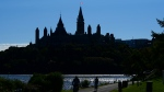 Cyclist make their way along the Ottawa River and past Parliament Hill in Gatineau, Quebec, Friday, Sept. 18, 2020. THE CANADIAN PRESS/Sean Kilpatrick