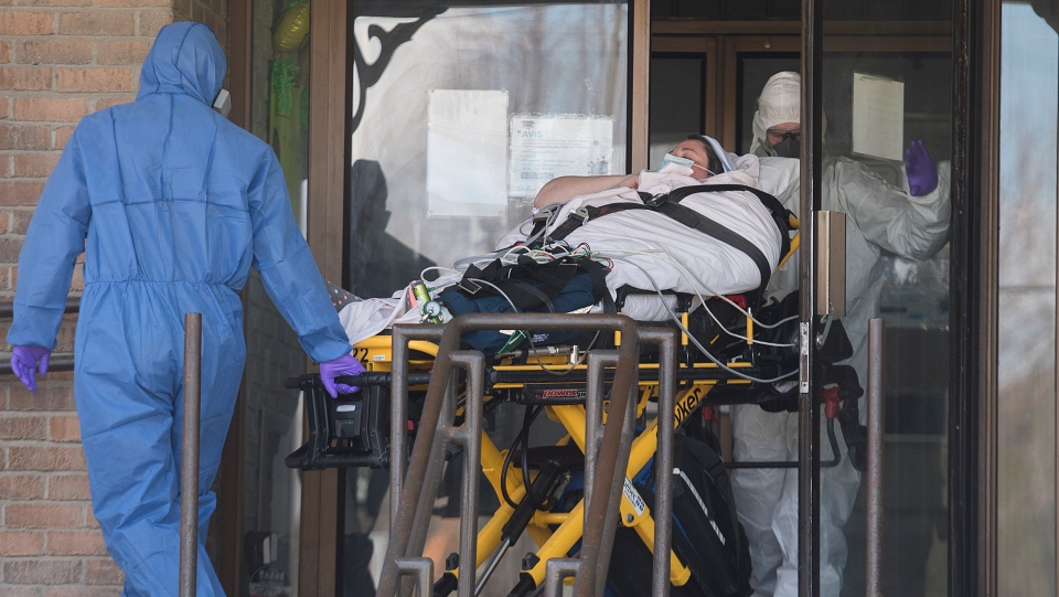 Paramedics transfer a patient from Residence Yvon-Brunet a long-term care home in Montreal, Saturday, April 18, 2020, as COVID-19 cases rise in Canada and around the world. THE CANADIAN PRESS/Graham Hughes