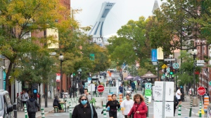 People walk along Mount Royal Avenue which has been turned into a pedestrian mall during the COVID-19 pandemic Wednesday, September 23, 2020 in Montreal.THE CANADIAN PRESS/Ryan Remiorz