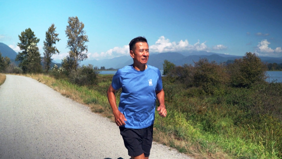 Dr. Michael Chow jogs as he recovers from COVID-19