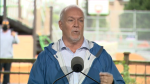 B.C. NDP Leader John Horgan speaks to reporters about child care during a campaign stop in Maple Ridge, B.C. on Sept. 24, 2020.