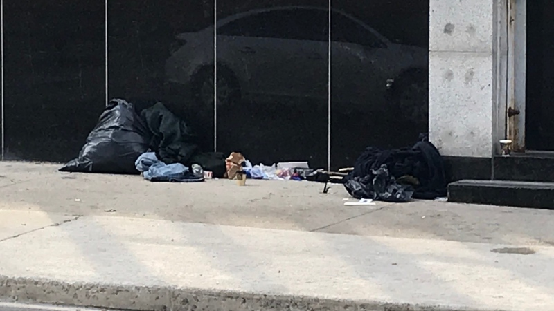 The belongings of a man sit in front of St. Thomas's post office, a frequent spot to rest, for the railway city's most vulnerable. 
