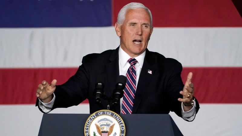 U.S. Vice-President Mike Pence speaks at a campaign rally, Tuesday, Sept. 22, 2020, at Lanconia Municipal Airport in Gilford, N.H. (AP Photo/Robert F. Bukaty)