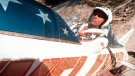 In this Sept. 8, 1974, file photo, Evel Knievel sits in the steam-powered rocket motorcycle that will hopefully take him across Snake River Canyon in Twin Falls, Idaho. (AP Photo, File)