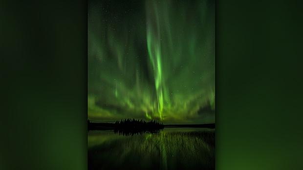 Early morning aurora's over Knee Lake, Manitoba. Photo by Wayne Boychuk.