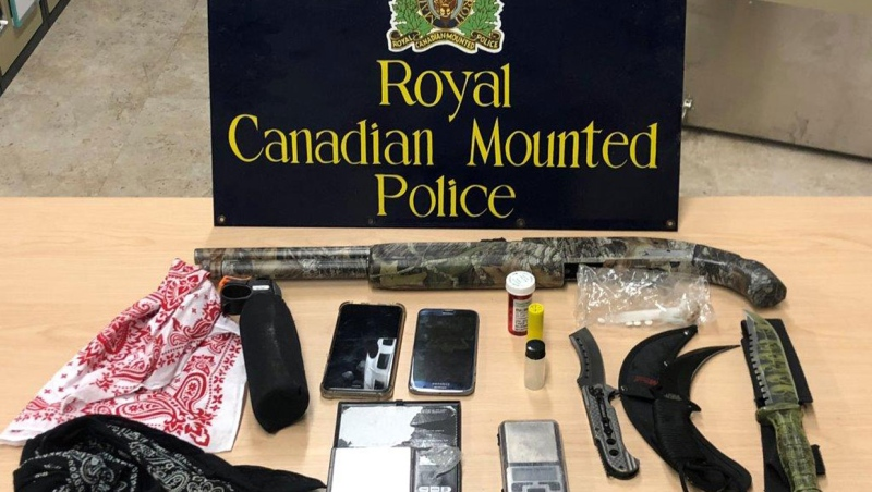 Airdrie RCMP seized a sawed-off shotgun, numerous weapons and drugs during a traffic stop on Sept. 18, 2020. (Supplied)
