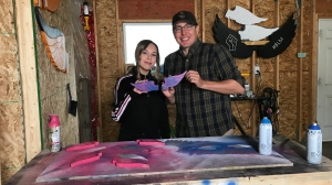 Loch Willy and his daughter Kiara spend hours in their workshop cutting and painting colourful wooden wings. (Janella Hamilton/CTV Saskatoon)