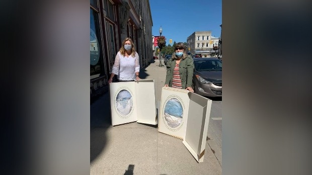 Cathy Prior (left) and Janet Hotson were reunited with their wedding dresses after 30 years (Stephanie Villella / CTV News Kitchener)