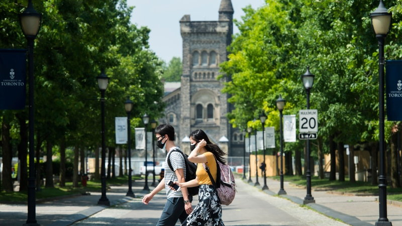 People walk past the University of Toronto campus In this June 10, 2020 file photo. For post-secondary graduates, the interest rate has been set to zero per cent for the federal portion of student loans, but loan repayments will continue. THE CANADIAN PRESS/Nathan Denette