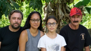 A group who have been stranded in Tahiti, pictured from left, Benjamin Baude, Kissy Ika Chavez Baude, Gaïa Baude Ika and Thierry Gourtay in Afareaitu on Moorea Island, Tahiti, Saturday, Sept. 19, 2020. (Teraihau Rio via AP)