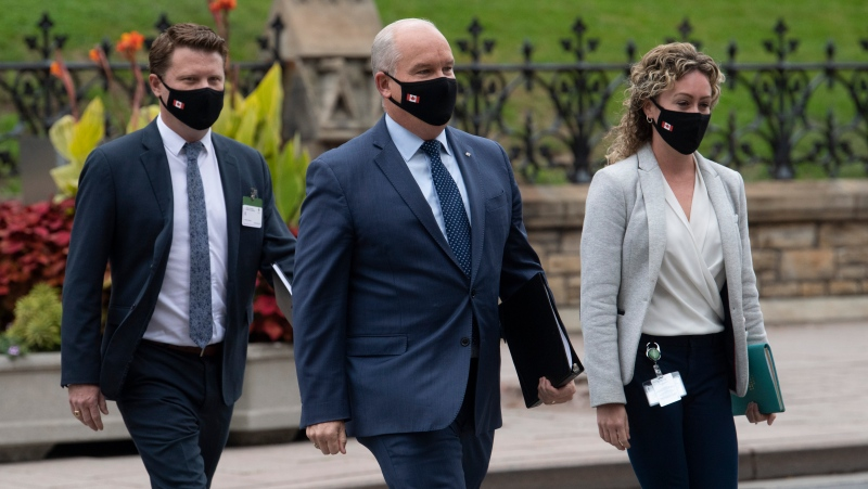 Conservative Leader Erin O'Toole walks to National Caucus wth his Chief of Staff Tausha Michaud and Campaign Manager Fred DeLorey Wednesday September 9, 2020 in Ottawa. (THE CANADIAN PRESS/Adrian Wyld)