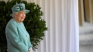 Queen Elizabeth II looks out during a ceremony to mark her official birthday at Windsor Castle in Windsor, England, Saturday June 13, 2020. (Toby Melville/Pool via AP)
