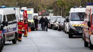 French police officers and rescue workers gather after four people have been wounded in a knife attack near the former offices of satirical newspaper Charlie Hebdo, Friday Sept. 25, 2020 in Paris. (AP Photo/Thibault Camus)