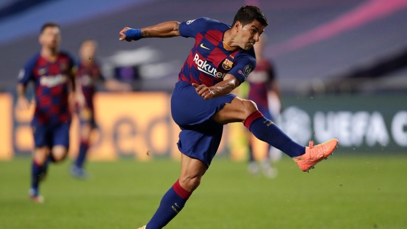 Barcelona's Luis Suarez after kicking the ball during the Champions League quarterfinal match between FC Barcelona and Bayern Munich at the Luz stadium in Lisbon, Portugal, Friday, Aug. 14, 2020. (AP Photo/Manu Fernandez/Pool)