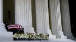A Supreme Court Honor Guard moves the flag-draped casket of Justice Ruth Bader Ginsburg back into the court as Ginsburg lies in repose under the Portico at the top of the front steps of the U.S. Supreme Court building on Thursday, Sept. 24 2020, in Washington. (AP Photo/Andrew Harnik, Pool)