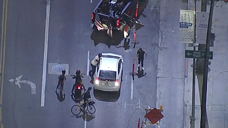 In this image made from aerial video, a vehicle is stopped by protesters in a truck during a protest against police brutality, Thursday, Sept. 24, 2020, in los Angeles. (ABC7 Los Angeles; via AP)