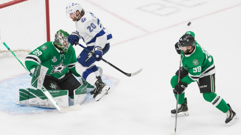 Dallas Stars goaltender Jake Oettinger (29) looks for the shot as Tampa Bay Lightning centre Blake Coleman (20) screens and the puck hits Stars defenceman Joel Hanley (39) during third period NHL Stanley Cup finals action in Edmonton on Sept. 23, 2020. (Jason Franson / THE CANADIAN PRESS)