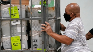 An employee load vote-by-mail ballots into a truck for transport to a local U.S. Postal Service office at the Broward Supervisor of Elections Office, Thursday, Sept. 24, 2020, in Lauderhill, Fla. Vote-by-mail ballots will begin going out to residents in Broward County Sept. 24. (AP Photo/Lynne Sladky)