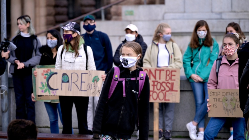 Swedish climate activist Greta Thunberg and others protest in front of the Swedish Parliament Riksdagen in Stockholm, on Sept. 25, 2020. (Janerik Henriksson / TT News Agency via AP)