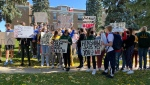 A protest outside the Lethbridge Public School District office on Sept. 24 calling for the return of school sports and extracurricular activities