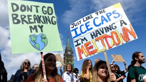People rally on Parliament Hill in Ottawa as part of a Global Climate Strike, protesting against climate change and inaction, on Friday, Sept. 27, 2019. THE CANADIAN PRESS/Justin Tang