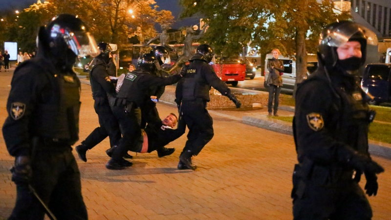 Riot police detain a protester during an opposition rally to protest the presidential inauguration in Minsk, Belarus, Wednesday, Sept. 23, 2020. (AP Photo/TUT.by)