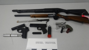 Canadian Border Services Agency Investigators and the RCMP seized a number of weapons from a home in Porters Lake, N.S., in September 2019. (Canada Border Services Agency)