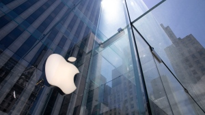 In this Tuesday, June 16, 2020 file photo, the sun is reflected on Apple's Fifth Avenue store in New York. (AP Photo/Mark Lennihan, File)