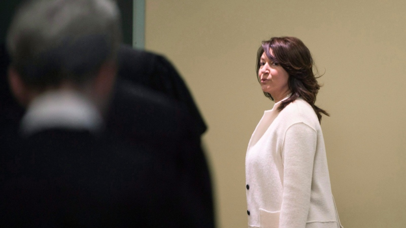 Former deputy premier Nathalie Normandeau looks toward a group of lawyers as she arrives in court, Monday, October 30, 2017 at the Quebec City Hall of Justice. THE CANADIAN PRESS/Jacques Boissinot
