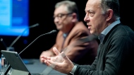 Quebec Health Minister Christian Dube, right, speaks during a news conference as Quebec Public Health Director Horacio Arruda looks on in Montreal, Sunday, September 20, 2020, where they provided an update on the COVID-19 pandemic in the province.THE CANADIAN PRESS/Graham Hughes