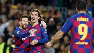 Barcelona's Lionel Messi, left, celebrates after scoring his side's second goal with Antoine Griezmann, centre and Luis Suarez during a Champions League soccer match, on Nov. 27, 2019. (Joan Monfort / AP)