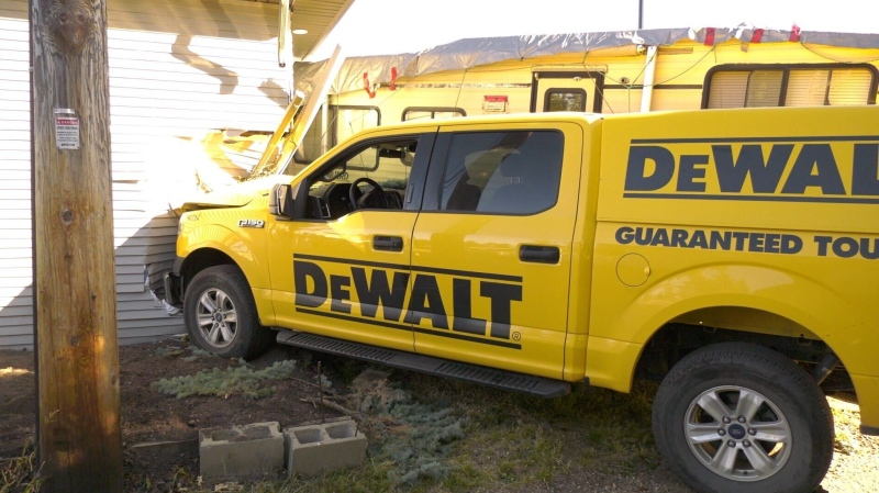 A man is in hospital after he crashed this truck into a garage on Friday, Sept. 25, 2020. (Jay Rosove/CTV News Edmonton)