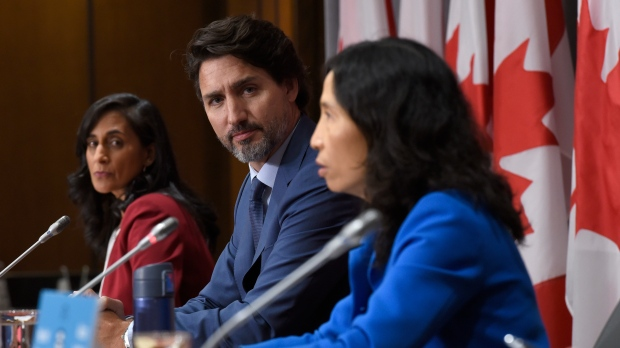 Prime Minister Justin Trudeau and Minister of Public Services and Procurement Anita Anand listen to Chief Public Health Officer of Canada Dr. Theresa Tam during a news conference on the COVID-19 pandemic on Parliament Hill in Ottawa, on Friday, Sept. 25, 2020. THE CANADIAN PRESS/Justin Tang