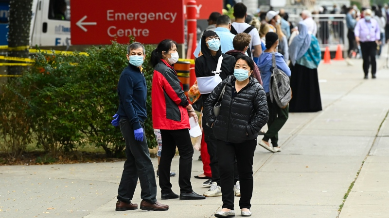 People wait in line for hours at a COVID assessment centre at Mount Sinai Hospital during the COVID-19 pandemic in Toronto on Thursday, September 24, 2020. (THE CANADIAN PRESS/Nathan Denette)