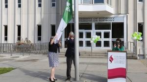 Raising the Franco-Ontarian flag at U of Sudbury. Sept. 25/20 (supplied)